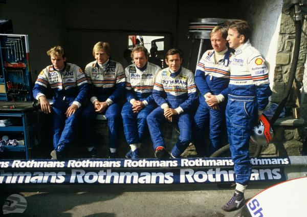 Rennteam Spa 1984, 02.09.1984 1000 km Spa; Rennteam v.l.n.r.: Stefan Bellof, Derek Bell, Jochen Mass, Jacky Ickx, Vern Schuppan und John Watson | © Porsche AG AG